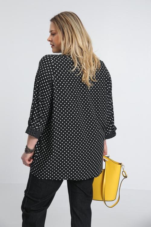 Black and white polka dot shirt
