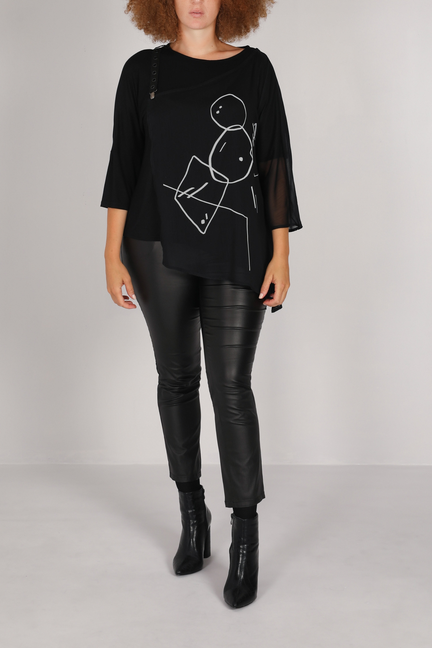 Top in asymmetric overlay