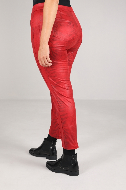 Printed faux leather trousers