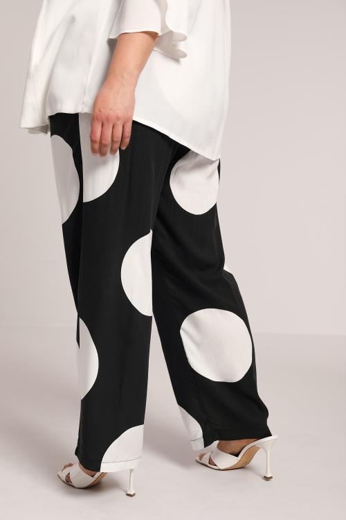 Polka dot print pants in fibranne
