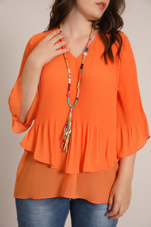Blouse lined in pleated veil