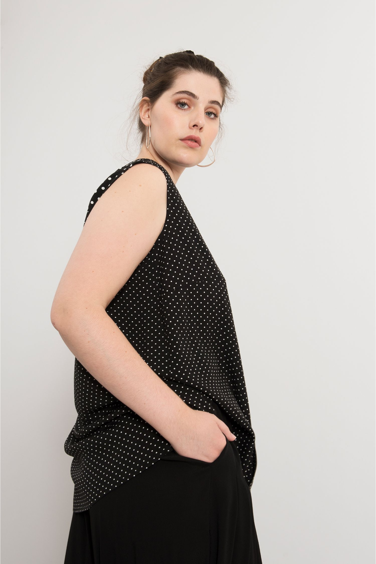 Sleeveless polka dot shirt