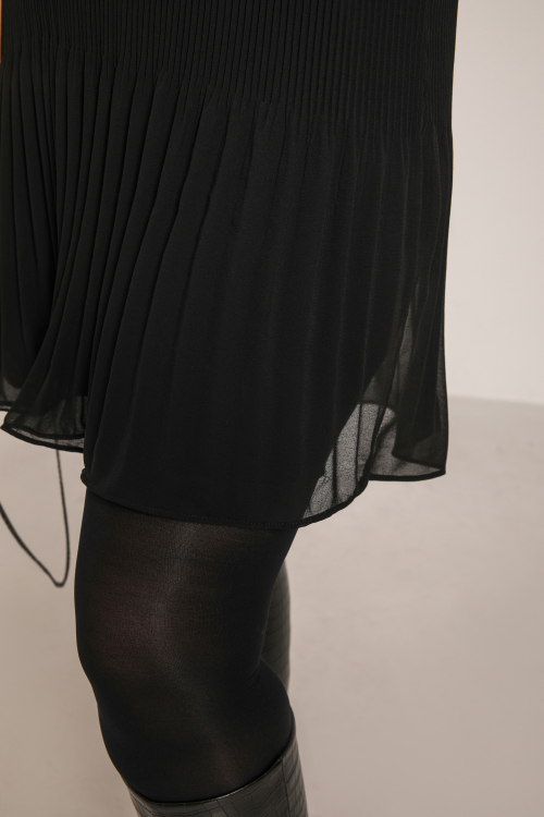 Pleated dress in lined veil