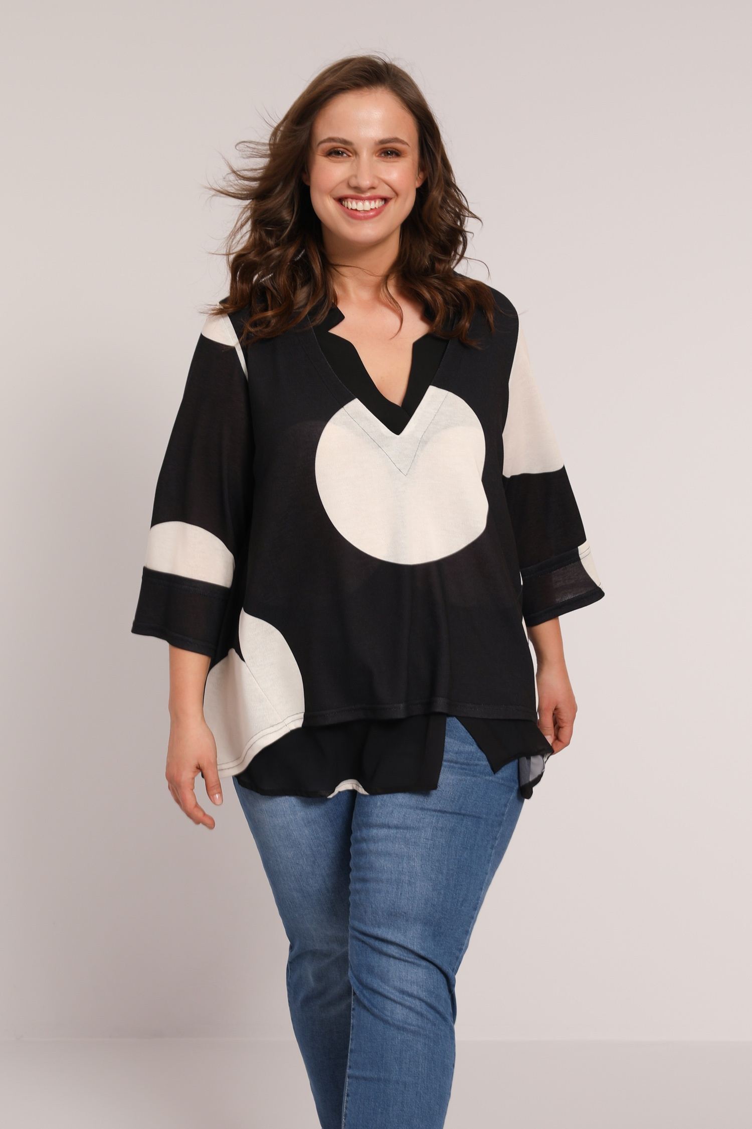 Polka-dot knit sweater and layered voile