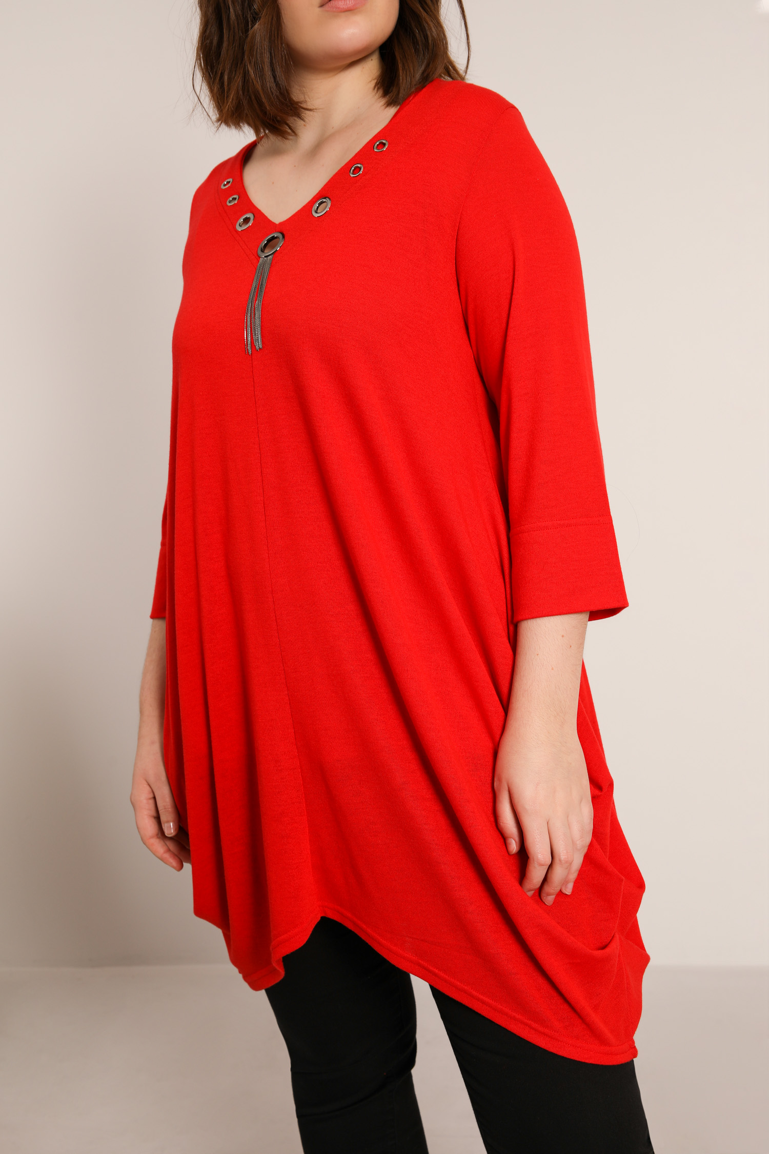 Knitted tunic with eyelets