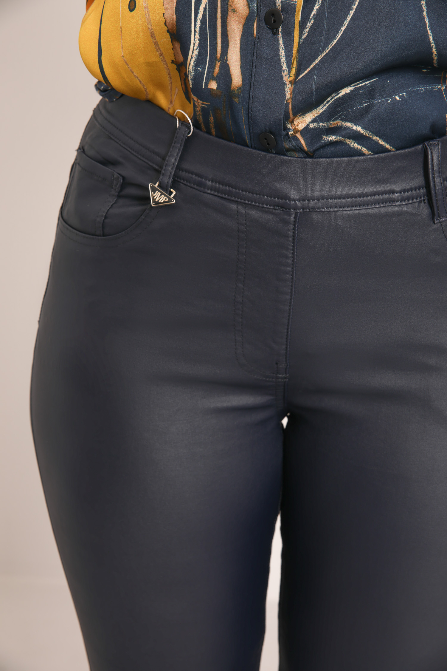 Coated slim jeans