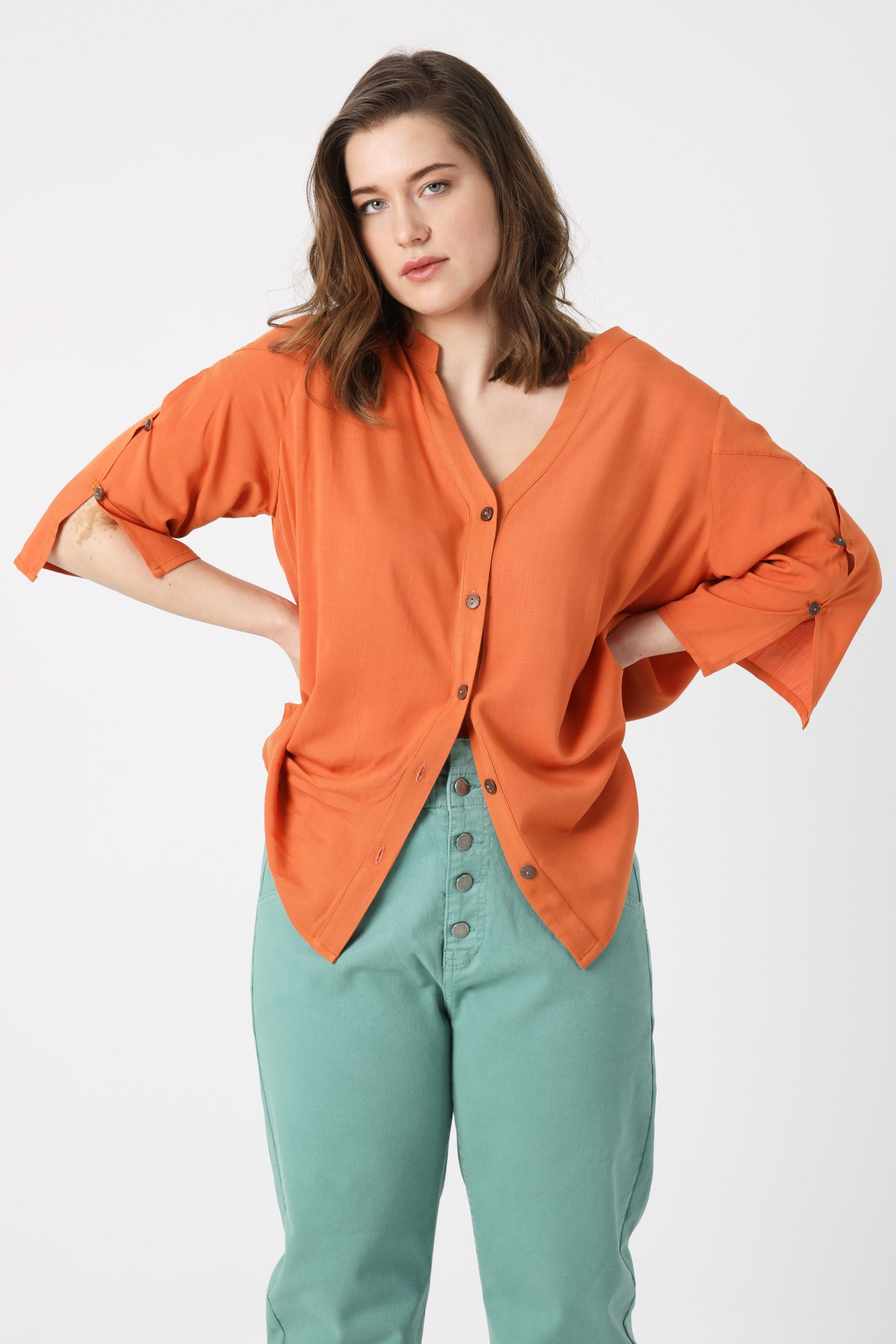 Plain blouse with buttoned cutout at the back.
