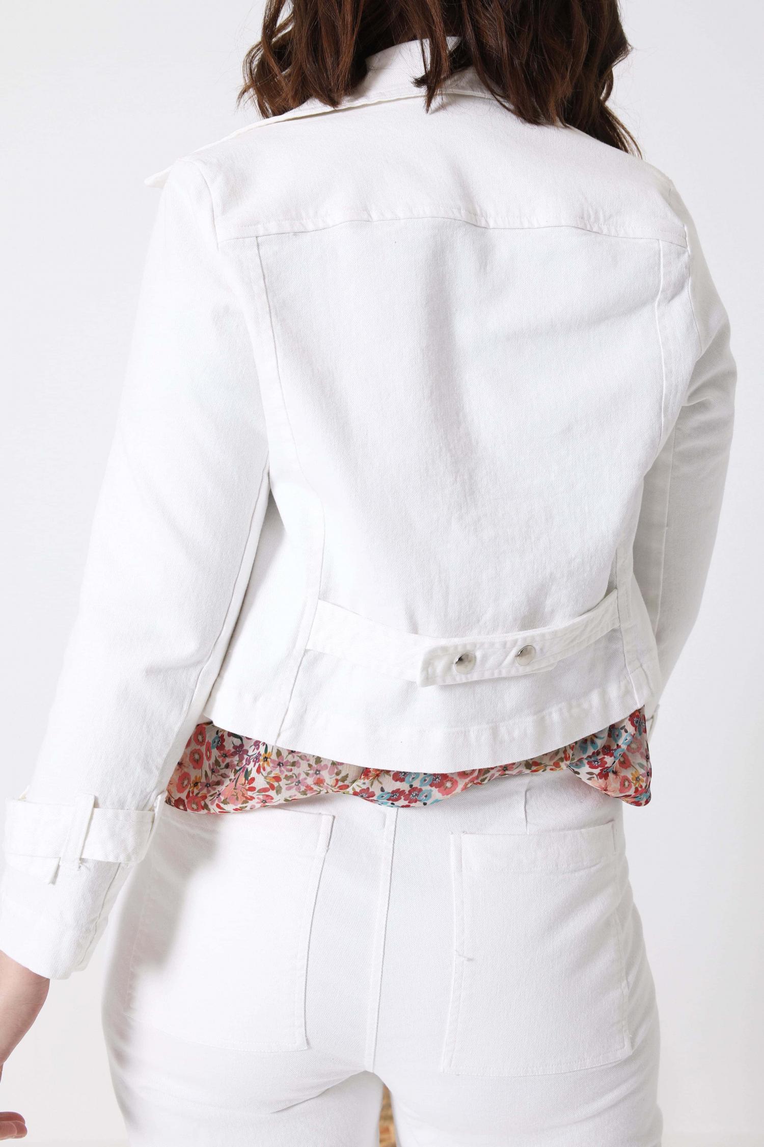 Biker style jacket in white jeans