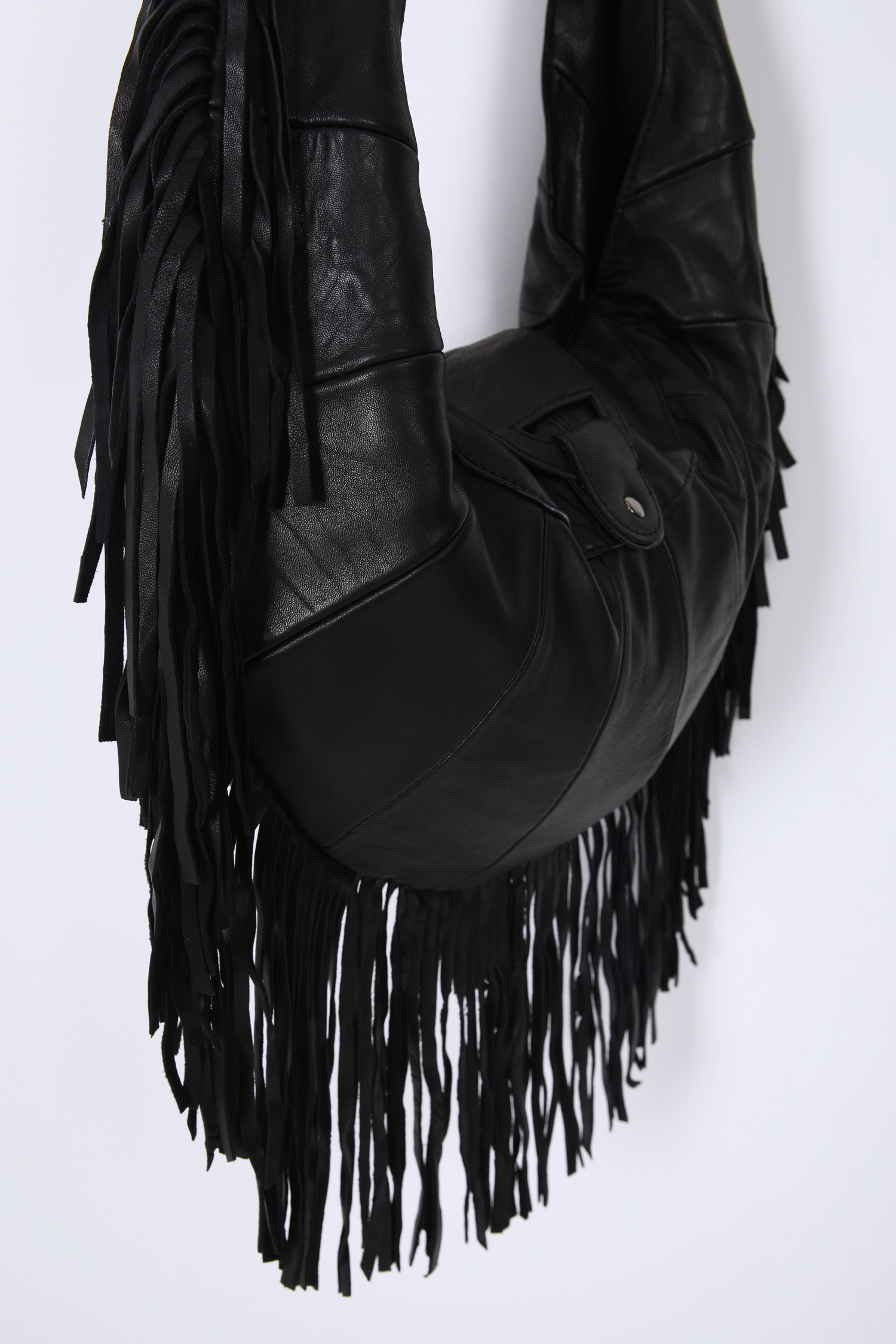 Fringed half-moon bag in leather